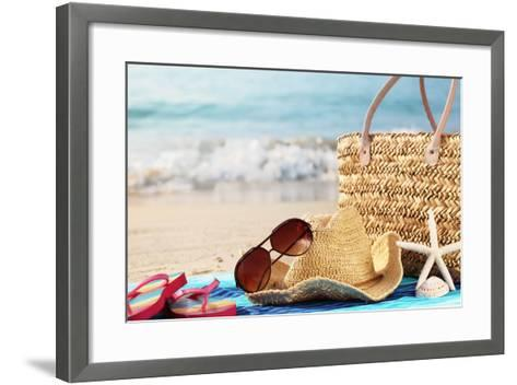 Summer Beach Bag with Straw Hat,Towel,Sunglasses and Flip Flops on Sandy Beach-Sofiaworld-Framed Art Print
