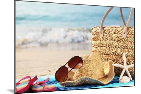Summer Beach Bag with Straw Hat,Towel,Sunglasses and Flip Flops on Sandy Beach-Sofiaworld-Mounted Photographic Print