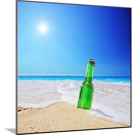 Beer Bottle on a Sandy Beach with Clear Sky and Wave, Shot with a Tilt and Shift Lens-buso23-Mounted Photographic Print