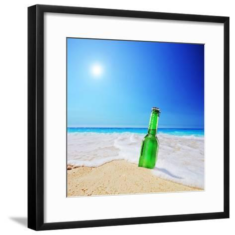Beer Bottle on a Sandy Beach with Clear Sky and Wave, Shot with a Tilt and Shift Lens-buso23-Framed Art Print