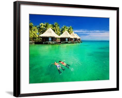Couple Snorkling in Tropical Lagoon with over Water Bungalows-Martin Valigursky-Framed Art Print