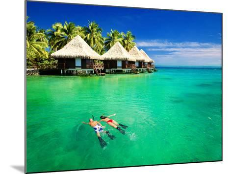 Couple Snorkling in Tropical Lagoon with over Water Bungalows-Martin Valigursky-Mounted Photographic Print