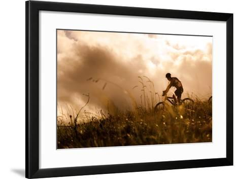Happy Couple Riding Bicycles Outside, Healthy Lifestyle Fun Concept. Silhouette at Sunset Panoramic-warrengoldswain-Framed Art Print