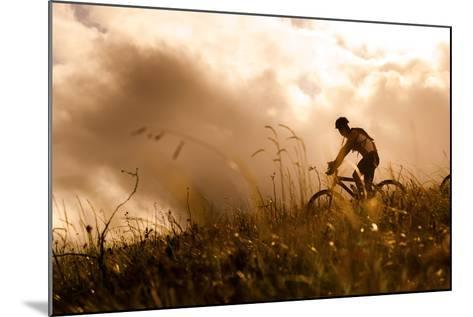 Happy Couple Riding Bicycles Outside, Healthy Lifestyle Fun Concept. Silhouette at Sunset Panoramic-warrengoldswain-Mounted Photographic Print