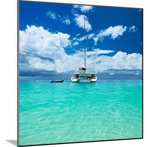 Beautiful Beach with Boat at Seychelles, Praslin, Anse Lazio-haveseen-Mounted Photographic Print