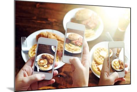 Friends Using Smartphones to Take Photos of Food with Instagram Style Filter-evren_photos-Mounted Photographic Print