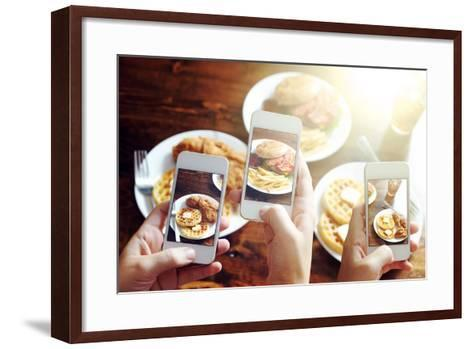 Friends Using Smartphones to Take Photos of Food with Instagram Style Filter-evren_photos-Framed Art Print