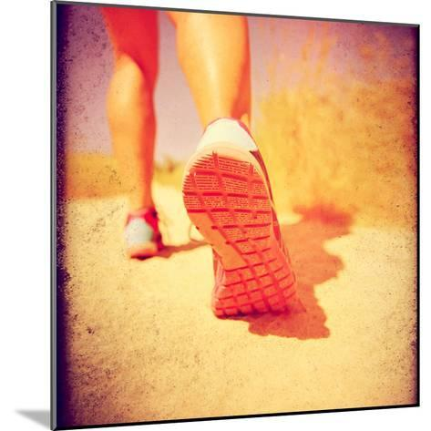 An Athletic Pair of Legs Running or Jogging on a Path during Summer Toned with a Soft Vintage Insta-graphicphoto-Mounted Photographic Print