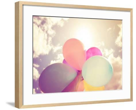 A Person Holding Multi Colored Balloons Done with a Retro Vintage Instagram Filter Effect-graphicphoto-Framed Art Print
