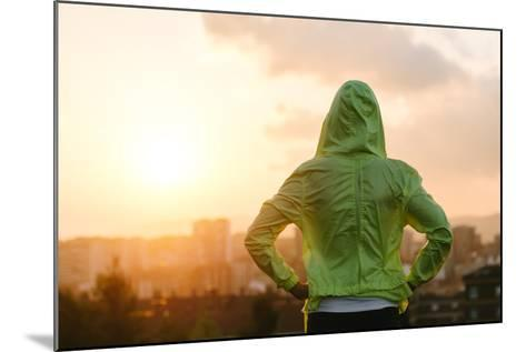 Athlete Looking Sunset over City Skyline after Exercising-Dirima-Mounted Photographic Print