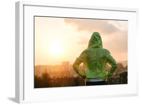 Athlete Looking Sunset over City Skyline after Exercising-Dirima-Framed Art Print