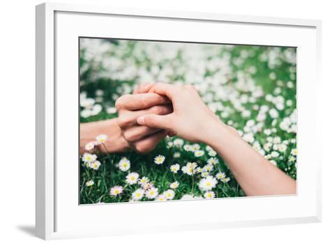 Lovers Holding Hands on Spring Flowers Field-Dirima-Framed Art Print