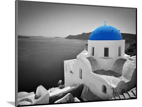Oia Town on Santorini Island, Greece. Black and White Styled with Blue Dome of Traditional Church O-Michal Bednarek-Mounted Photographic Print