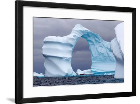 Huge Arch Shaped Iceberg in Antarctica-slew11-Framed Art Print