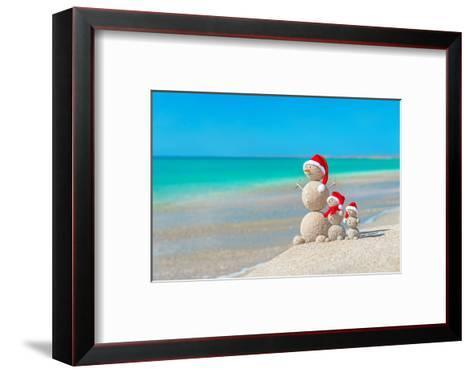 Snowmans Family at Sea Beach in Santa Hat. New Years and Christmas-EMprize-Framed Art Print