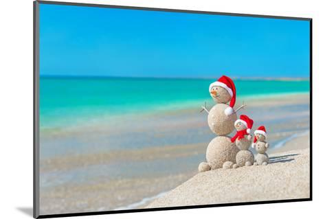 Snowmans Family at Sea Beach in Santa Hat. New Years and Christmas-EMprize-Mounted Photographic Print