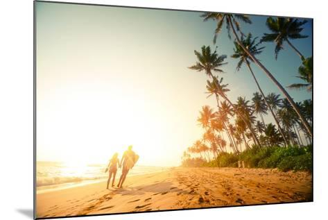 Couple Walking on the Sandy Beach with Palm Trees-Dudarev Mikhail-Mounted Photographic Print
