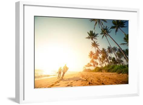 Couple Walking on the Sandy Beach with Palm Trees-Dudarev Mikhail-Framed Art Print