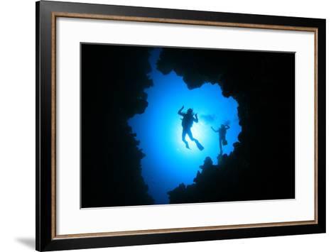 Couple of Scuba Divers Descend into an Underwater Cavern-Rich Carey-Framed Art Print