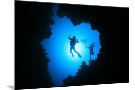 Couple of Scuba Divers Descend into an Underwater Cavern-Rich Carey-Mounted Photographic Print