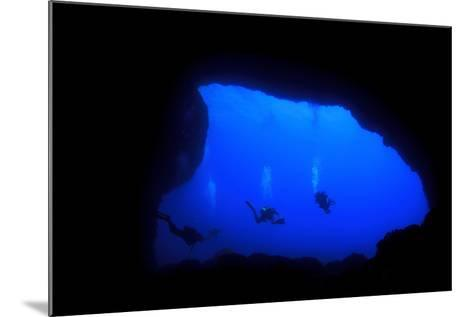 Into Darkness: Underwater Cave Scuba Diving Silhouettes-Rich Carey-Mounted Photographic Print