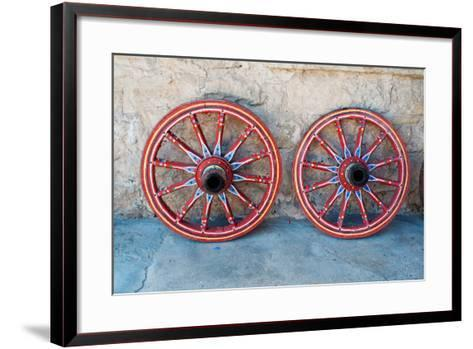 Wagon Wheel . Close-Up of an Antique Wagon Wheel Located in A Fortress.-maggee-Framed Art Print