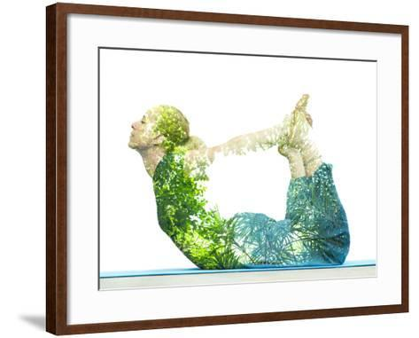 Combining Nature with Spiritual Yoga in a Creative Portrait of a Young Woman Lying with Her Body Ar-Victor Tongdee-Framed Art Print