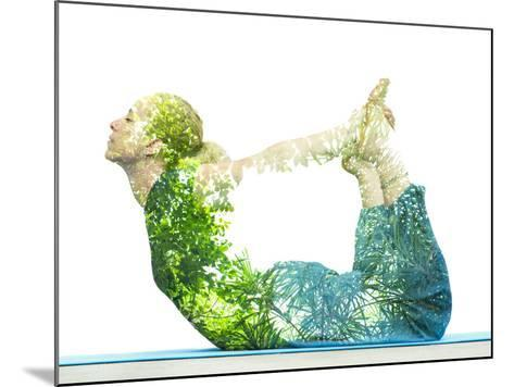 Combining Nature with Spiritual Yoga in a Creative Portrait of a Young Woman Lying with Her Body Ar-Victor Tongdee-Mounted Photographic Print
