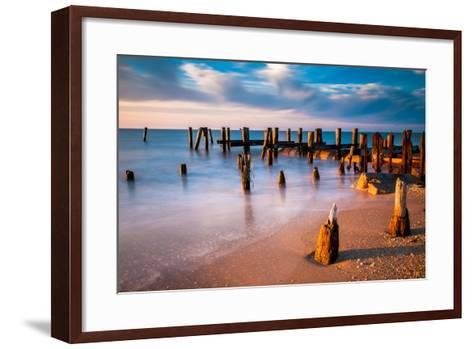 Long Exposure at Sunset of Pier Pilings in the Delaware Bay at Sunset Beach, Cape May, New Jersey.-Jon Bilous-Framed Art Print