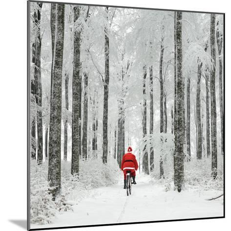 Father Christmas on a Bicycle in Snow--Mounted Photographic Print