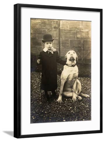 Little Boy with Large Bulldog in a Garden, France--Framed Art Print