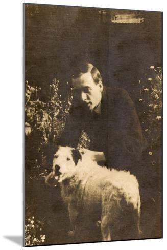 Man with a Terrier in a Garden--Mounted Photographic Print