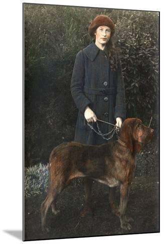Young Woman with a Dog in a Garden--Mounted Photographic Print