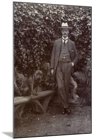 Man with a Bulldog in a Garden--Mounted Photographic Print