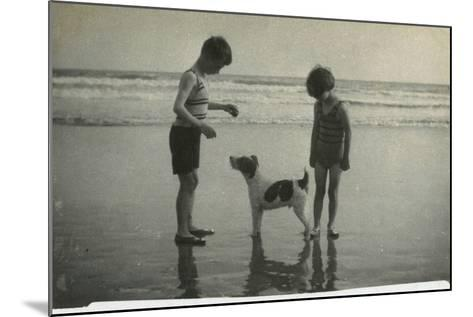 Two Children on Beach with Dog--Mounted Photographic Print