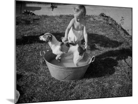 Toddler Giving Dog a Bath in the Garden--Mounted Photographic Print