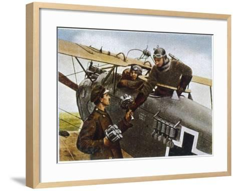 German Fighter Plane Loads up with Hand-Grenades Before a Mission--Framed Art Print