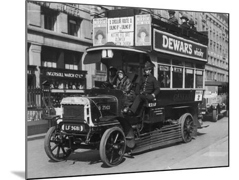 Bus Gets Police Protection During the General Strike--Mounted Photographic Print