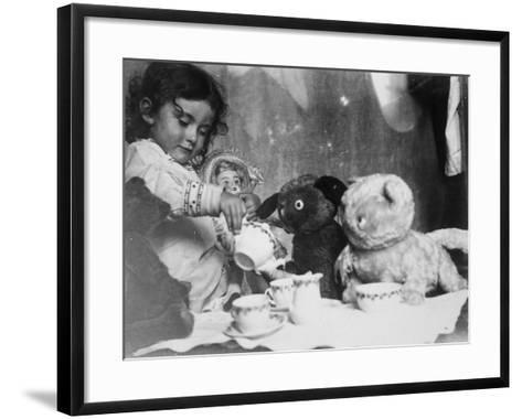 Little Girl Hosts a Tea Party, Three Bears and a Doll Attend--Framed Art Print