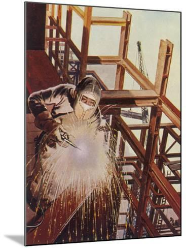 Welder Uses an Electric Arc- Welding Tool to Join the Metal Parts of a Steel Structure--Mounted Photographic Print
