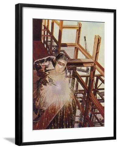 Welder Uses an Electric Arc- Welding Tool to Join the Metal Parts of a Steel Structure--Framed Art Print