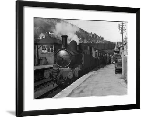 People Board a Steam Train Waiting in the Station--Framed Art Print