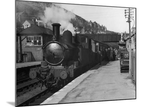 People Board a Steam Train Waiting in the Station--Mounted Photographic Print