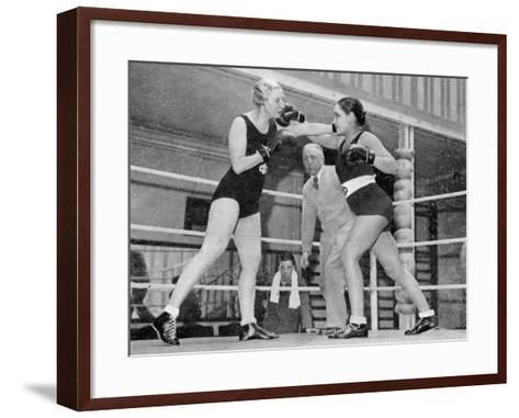 Two Women Box in a Ring, with a Referee Present--Framed Art Print