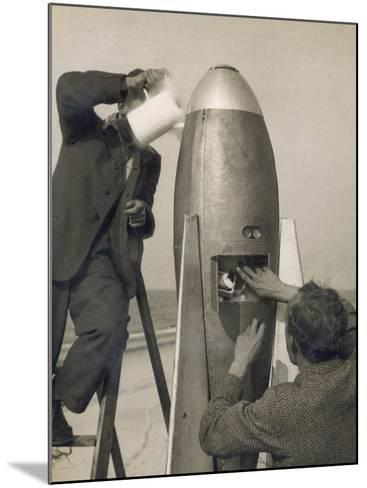 German Rocket Experiments on a Windswept Spit of Land, Filling the Device with Its Chemical Fuel--Mounted Photographic Print