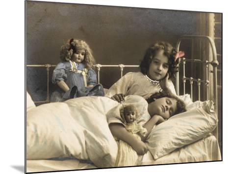 Two Sisters Prepare for Bed - and of Course their Dolls Come to Bed with Them--Mounted Photographic Print