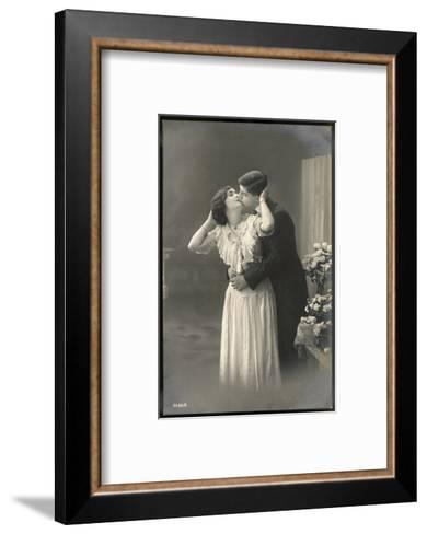 Two Lovers Embrace and Kiss--Framed Art Print