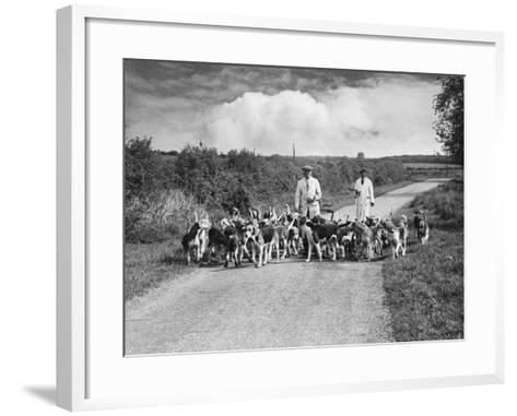 Two Kennel Workers Exercising Foxhounds on an English Country Lane--Framed Art Print