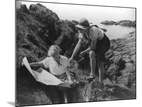 Two Female Hikers on a Coastal Route Stop and Consult their Map--Mounted Photographic Print