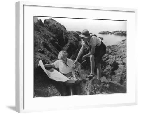 Two Female Hikers on a Coastal Route Stop and Consult their Map--Framed Art Print